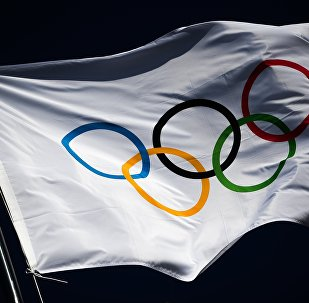 The Olympic flag flutters above the medals plaza at the Hwaenge Olympic Park in Pyeongchang, the Republic of Korea where winners of the 2018 Winter Olympics will be awarded