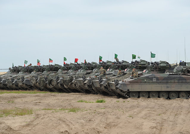 German army tanks line up during the course of the NATO Noble Jump exercise on a training range near Swietoszow Zagan, Poland, June 2015. The German military has seen an increase in deployments for exercises in Eastern Europe and on Russia's borders since the start of the Ukrainian crisis in February 2014.
