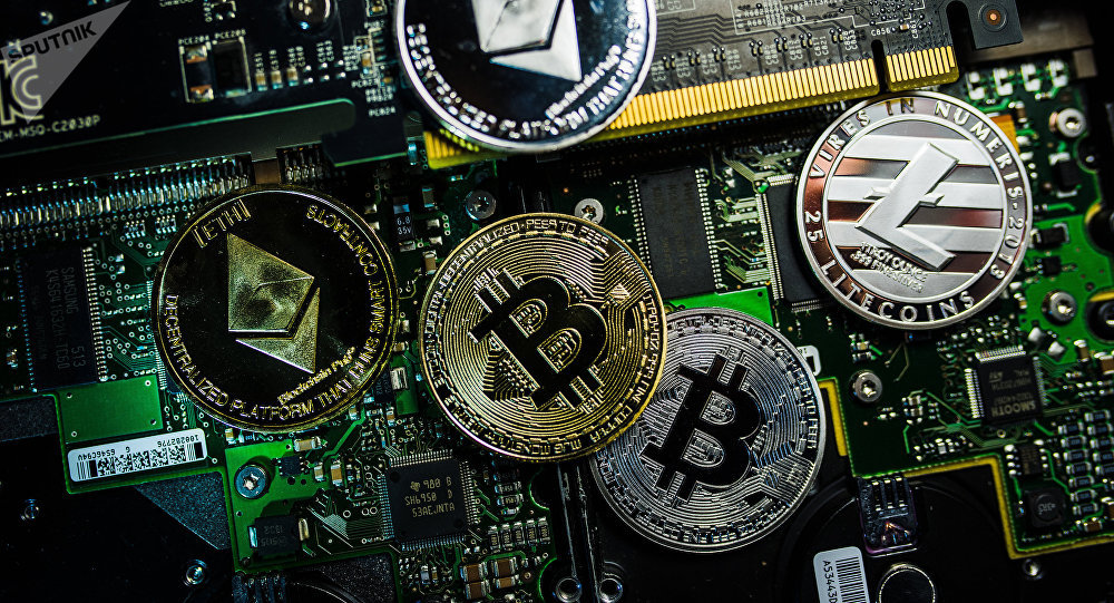 Souvenir coins with the cryptocurrency logos of Bitcoin, Litecoin and Ethereum