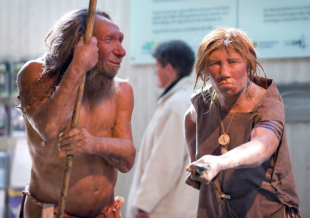 The prehistoric Neanderthal man N, left, is visited for the first time by another reconstruction of a homo neanderthalensis called Wilma, right, at the Neanderthal museum in Mettmann, Germany, Friday, March 20, 2009