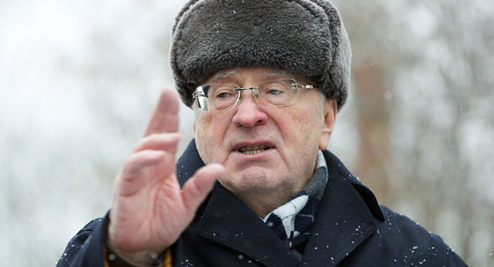 Leader of the Liberal Democratic Party of Russia Vladimir Zhirinovsky, center, visits The Red Pine dog shelter in Moscow