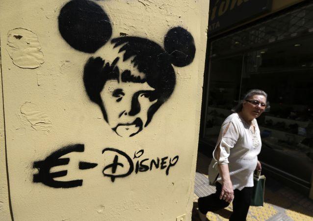 Graffiti con la cancelliera tedesca Angela Merkel ad Atene.