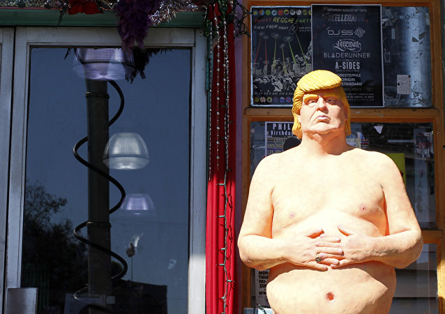 In this Aug. 18, 2016 photo, a statue of presidential hopeful Donald Trump is placed outside a shop in the Hollywood section of Los Angeles.