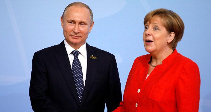 German Chancellor Angela Merkel welcomes Russia's President Vladimir Putin at the G20 summit in Hamburg, Germany July 7, 2017