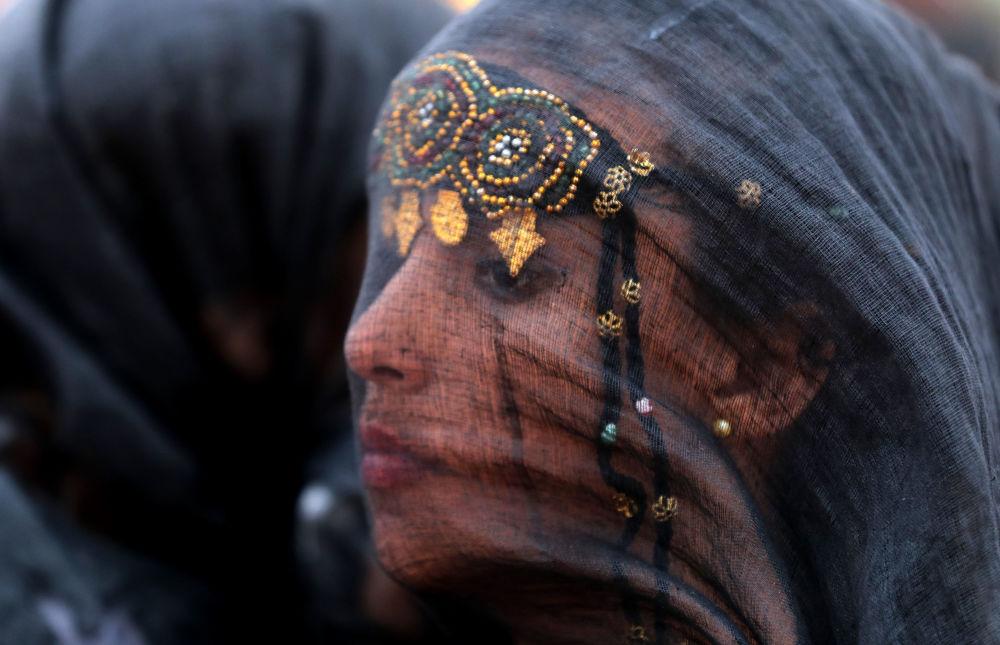 Una partecipante del festival Tan-Tan Moussem Berber, Marocco.