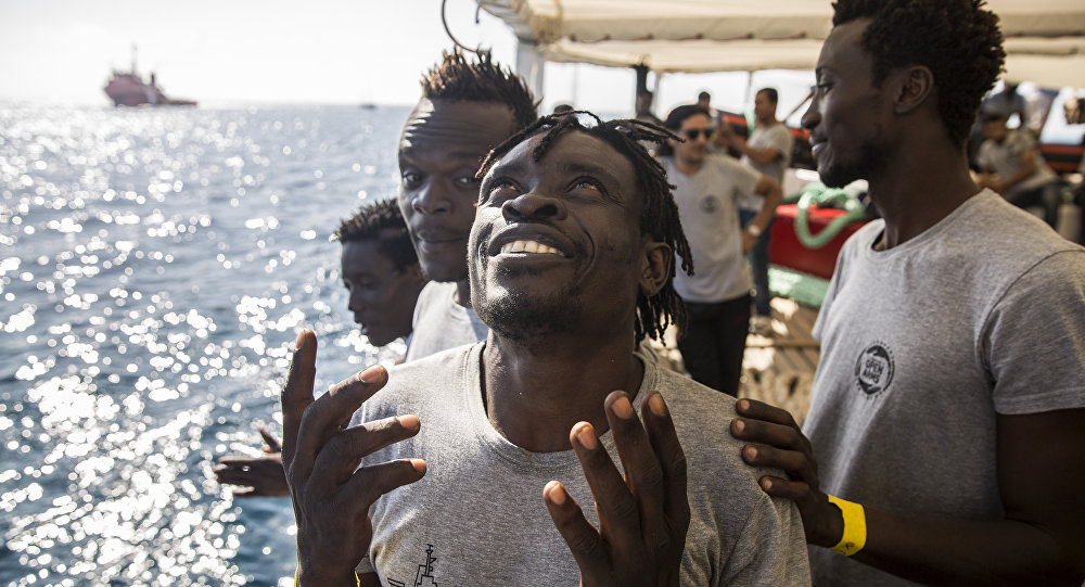 Migranti a bordo della nave di Open Arms
