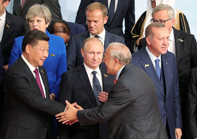 July 7, 2017. Russian President Vladimir Putin during a group photo session of the G20 heads of state, invited countries and international organizations in Hamburg. At left in the foreground: Chinese President Xi Jinping; right: President of Turkey Recep Tayyip Erdogan