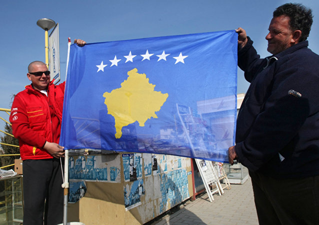 Residents of Pristina holding a new flag of the self-proclaimed republic of Kosovo