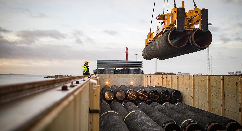 Pipes are loaded onto a vessel in the northern German port of Mukran for transshipment to a storage yard