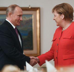 G20 a Buenos Aires, Vladimir Putin con Angela Merkel