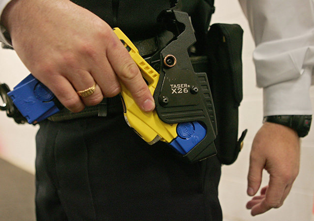 A file photo taken 05 December 2007 shows a British police officer holding a taser gun during a training session at the Metropolitan Police Specialist Training Centre, in Gravesend, Kent, in southeast England