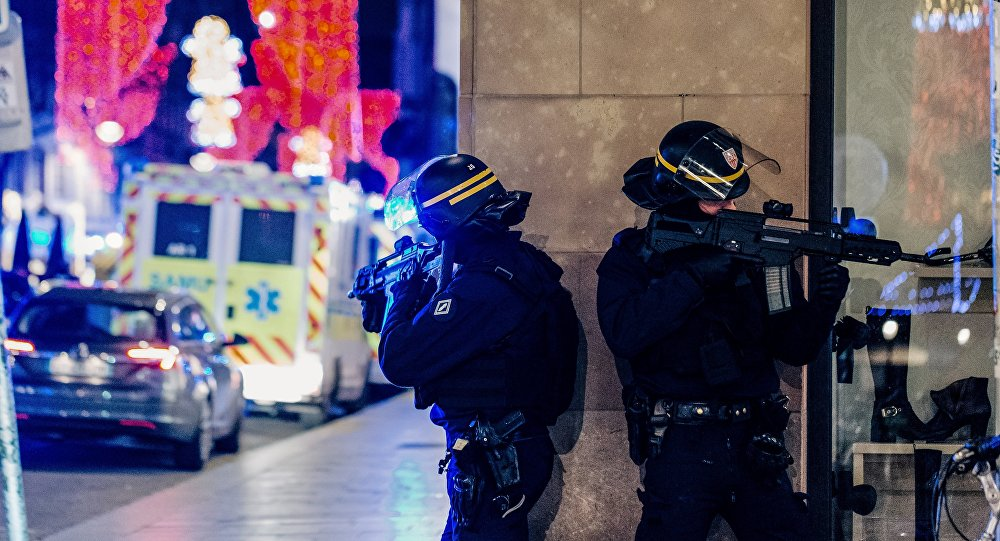 French police officers stand guard near the scene of a shooting on December 11, 2018 in Strasbourg, eastern France.