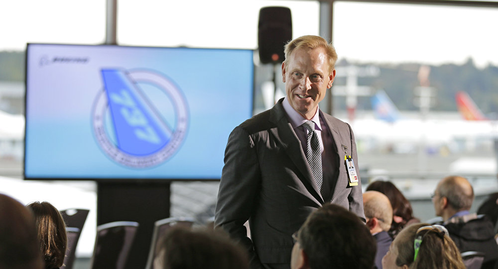 Pat Shanahan, senior vice president of Airplane Programs for Boeing Commercial Airplanes, greets guests at a re-opening ceremony for Boeing's newly expanded 737 delivery center, Monday, Oct. 19, 2015, at Boeing Field in Seattle