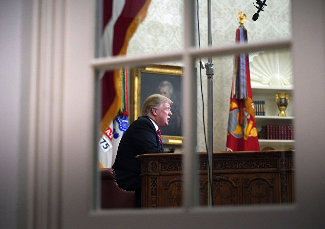 As seen from a window outside the Oval Office, President Donald Trump gives a prime-time address about border security Tuesday, Jan. 8, 2018, at the White House in Washington