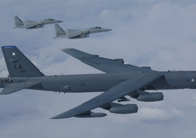 A B-52H Stratofortress bomber aircraft integrated with the Koku Jieitai (Japan Air Self Defense Force) while conducting a routine training mission in the East China Sea and Sea of Japan Sep. 26, 2018