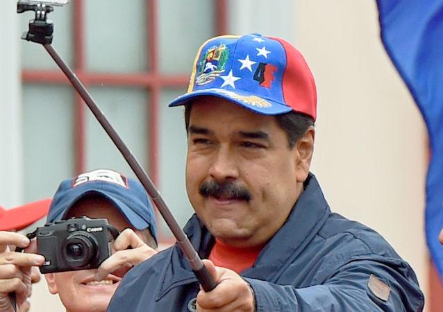 Президент Венесуэлы Николас Мадуро во время марша в Международный День труда (1 мая 2016). Каракас