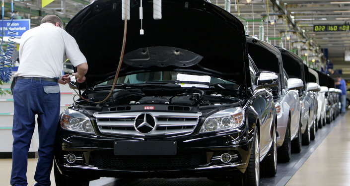 An employee of German car producer Mercedes-Benz controling a Mercedes C-class as it rolls off the production line in the plant in Sindelfingen near Stuttgart, Germany