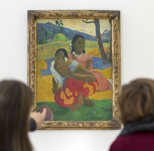 Women look at the painting Nafea faa ipoipo? (1892) by French painter Paul Gauguin in the Fondation Beyeler in Riehen, Switzerland