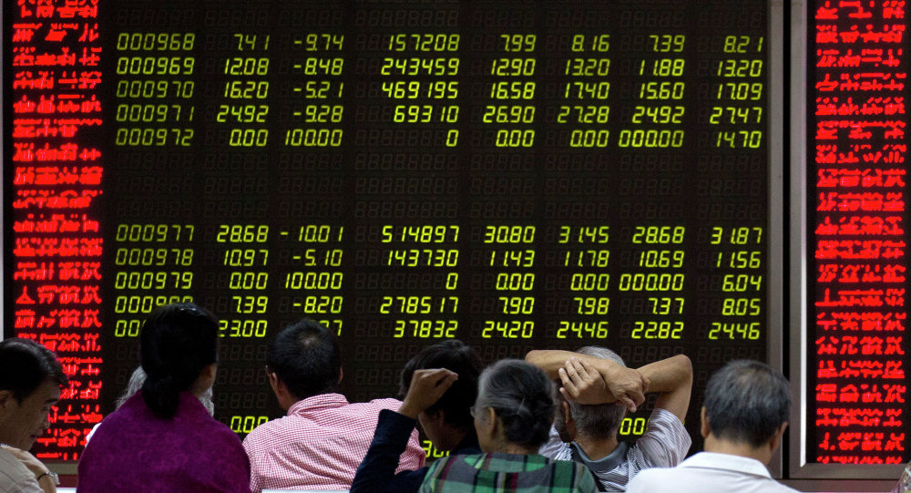 Investors monitor stock prices at a brokerage in Beijing, Friday, Aug. 21, 2015