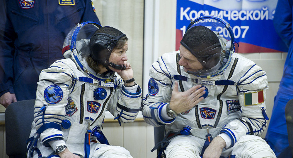 Expedition 26 Soyuz Flight Engineer Catherine Coleman, left, and European Space Agency astronaut Paolo Nespoli