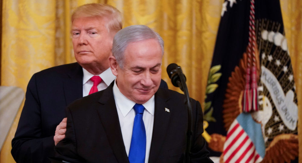 U.S. President Donald Trump puts his hands on Israel's Prime Minister Benjamin Netanyahu's shoulders as they deliver joint remarks on a Middle East peace plan proposal in the East Room of the White House in Washington, U.S., January 28, 2020.