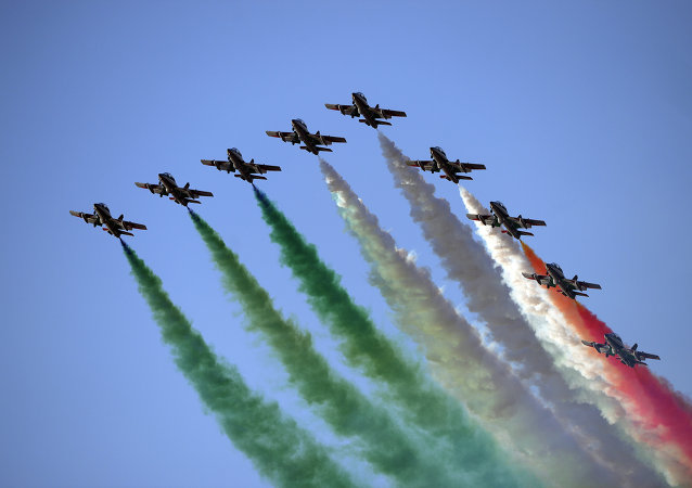Members of the Italian Air Force, the 'Frecce Tricolori', perform with their Aermacchi MB-339 aircraft during the International Air Show at the Hungarian Air Force base in Kecskemet, southern Hungary