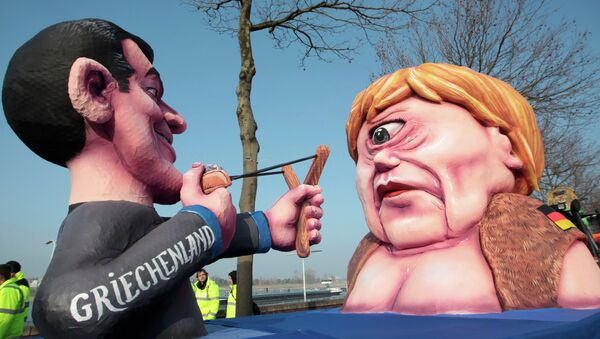 A carnival float with papier-mache caricatures of German Chancellor Angela Merkel (R) and a figure representing Greece (L) takes part in the traditional Rose Monday carnival parade in the western German city of Duesseldorf February 16, 2015 - Sputnik Italia
