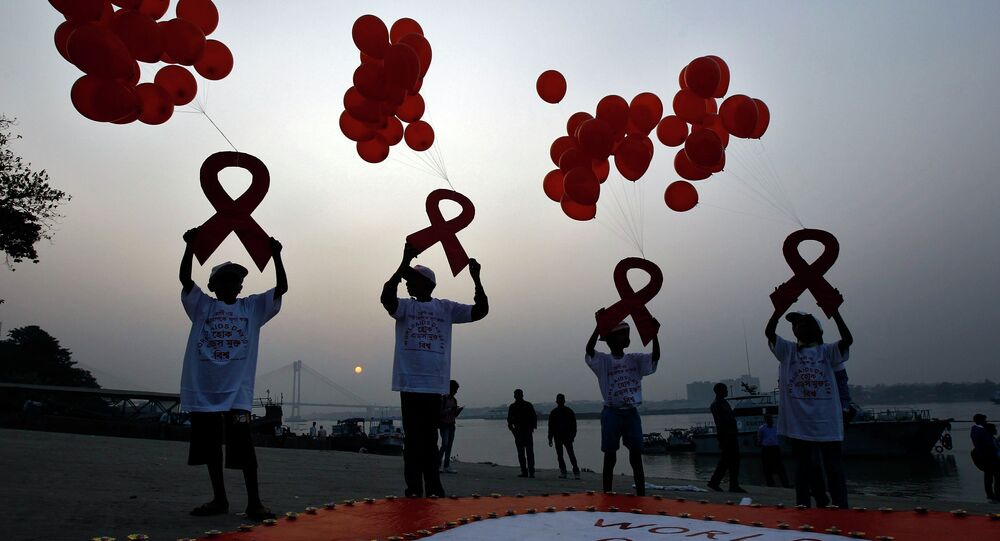 Children display ribbon cut-outs tied to balloons during an HIV/AIDS awareness campaign to mark World AIDS Day in Kolkata December 1, 2014. The world has finally reached the beginning of the end of the AIDS pandemic that has infected and killed millions in the past 30 years, according to a leading campaign group fighting HIV. United Nations data show that in 2013, 35 million people were living with HIV, 2.1 million people were newly infected with the virus and some 1.5 million people died of AIDS. By far the greatest part of the HIV/AIDS burden is in sub-Saharan Africa.