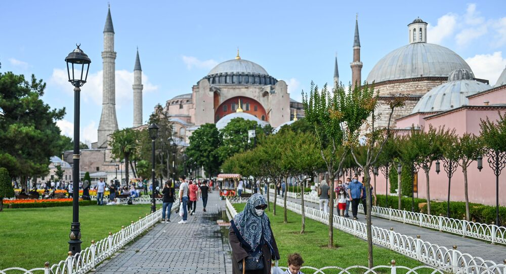 People walk in front of Hagia Sophia on July 11, 2020 in Istanbul, a day after a top Turkish court revoked the sixth-century Hagia Sophia's status as a museum, clearing the way for it to be turned back into a mosque.