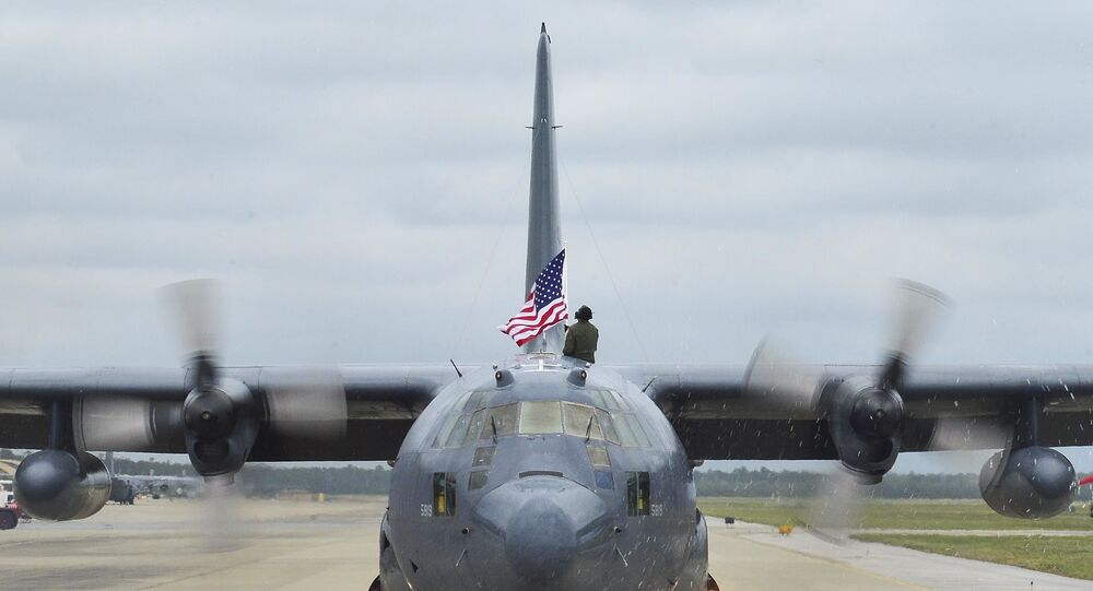 Tech. Sgt. Bruce Ramos, a 1st Special Operations Group Detachment 1 radio operator, raises an American flag from an MC-130P Combat Shadow while it taxis at Hurlburt Field, Fla., May 15, 2015.