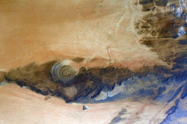 La Struttura di Richat (chiamata anche Occhio del Sahara), una struttura circolare nel Deserto del Sahara vicino ad Ouadane in Mauritania, vista dalla Stazione Spaziale Internazionale - Sputnik Italia