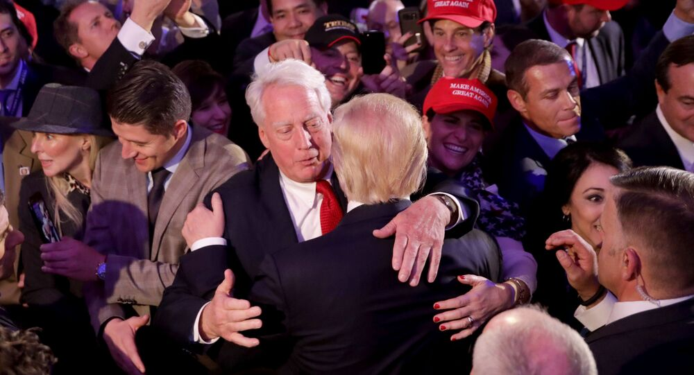 In this file photo taken on November 09, 2016 Republican president-elect Donald Trump (front) hugs his brother Robert Trump after delivering his acceptance speech in New York City. - The WHite House announced Robert Trump, younger brother of US president Donald Trump, born in 1948, died August 15, 2020 at a New York hospital