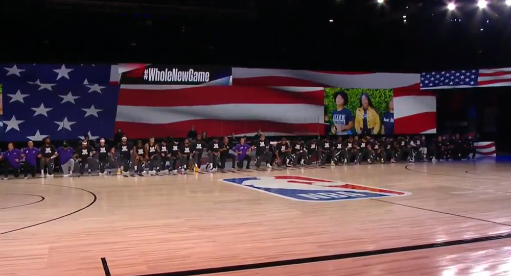 Screenshot of the video showing NBA players kneeling in solidarity with Black Lives Matter movement