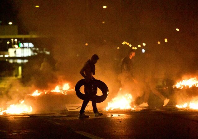 Demonstrators burn tyres during a riot in the Rosengard neighbourhood of Malmo, Sweden August 28, 2020.