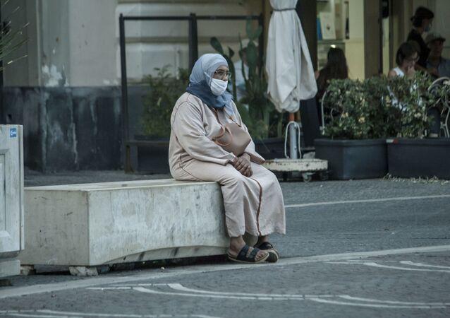 Una migrante in Italia