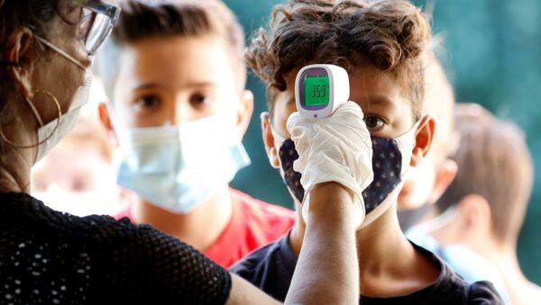 Controllo della temperatura dopo riapertura delle scuole a Roma, Italia, il 14 settembre 2020 - Sputnik Italia