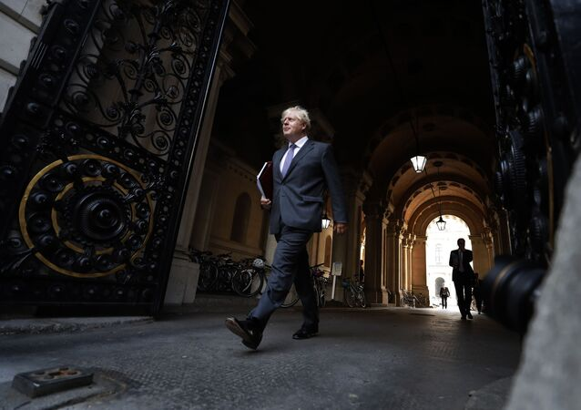 Britain's Prime Minister Boris Johnson walks to his office in Downing Street after a cabinet meeting in London, Tuesday, Sept. 15, 2020.