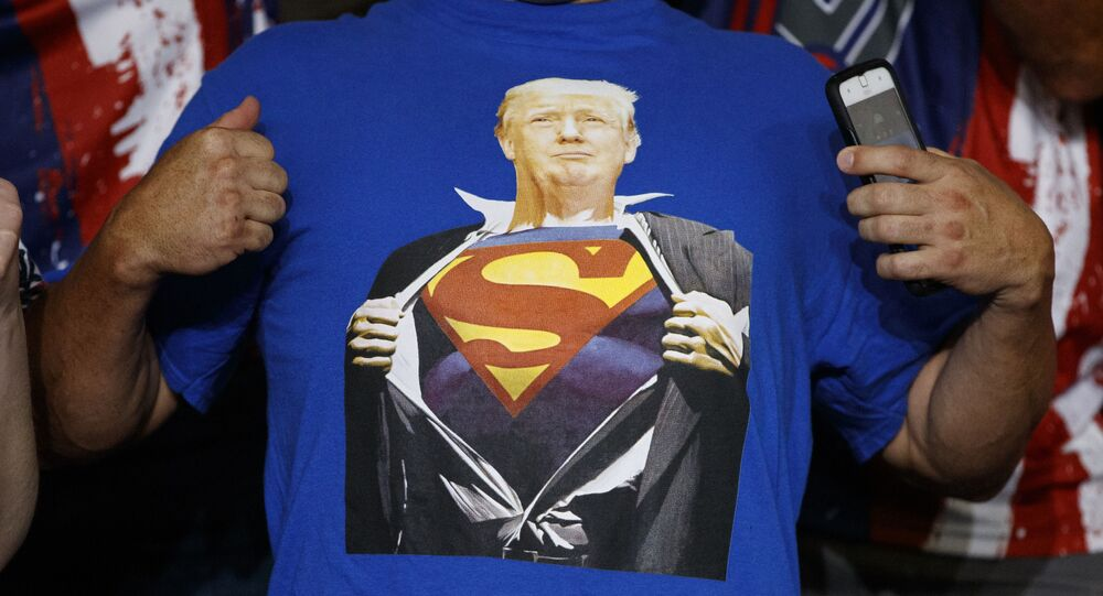 A supporter of President Donald Trump wears a t-shirt with the image of the president as Superman at a campaign rally at Williams Arena in Greenville, N.C., Wednesday, July 17, 2019.