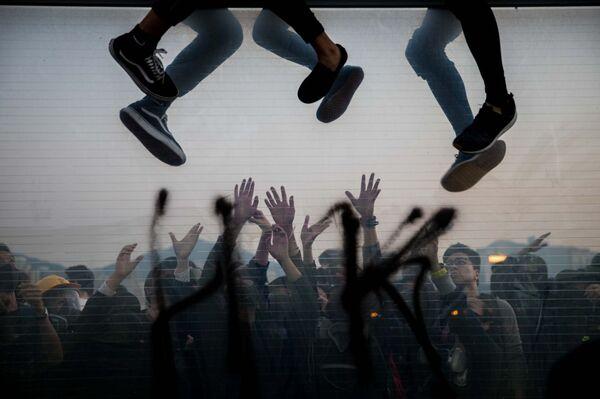 La foto In fuga del fotografo di Hong Kong Shawn Yuan,  che è stata la terza nella categoria  Documentario e fotogiornalismo del concorso Siena International Photo Awards 2020.  - Sputnik Italia