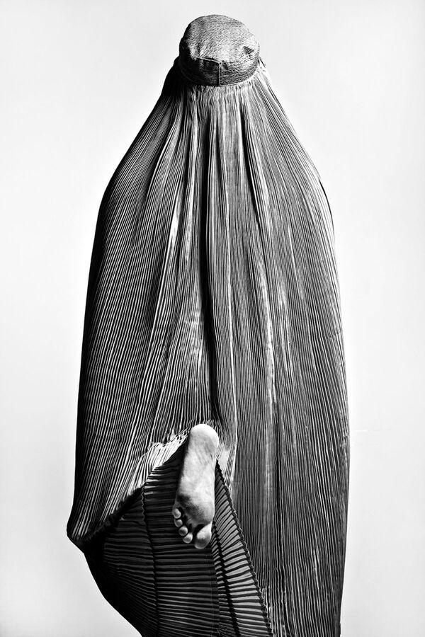 La foto Taboo del fotografo iraniano Fattah Zinouri, che è stata la seconda nella categoria  Volti affascinanti del concorso Siena International Photo Awards 2020.  - Sputnik Italia
