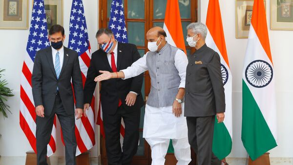 India's Defence Minister Rajnath Singh gestures to show the way to US Secretary of State Mike Pompeo and US Defense Secretary Mark Esper after they posed for a picture with India's Foreign Minister Subrahmanyam Jaishankar during a photo opportunity ahead of their meeting at Hyderabad House in New Delhi, India, October 27, 2020 - Sputnik Italia