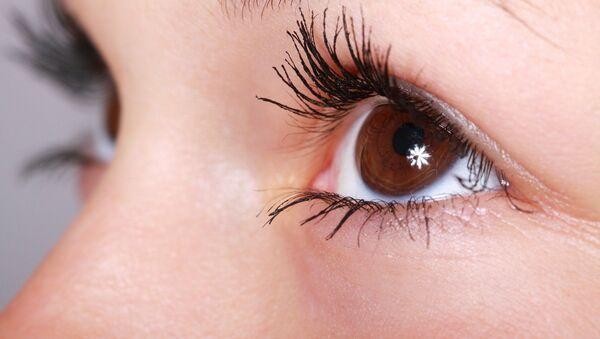 Ojos de una mujer (imagen referencial) - Sputnik Italia