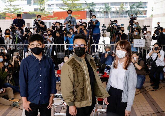 Gli attivisti di Hong Kong Joshua Wong,  Ivan Lam, Agnes Chow