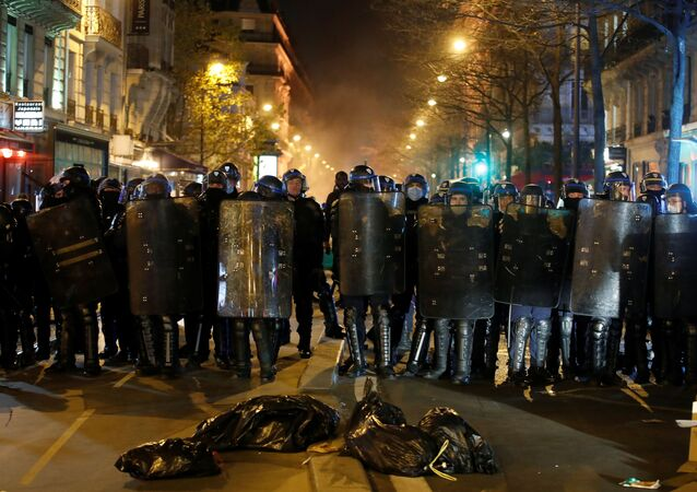 French CRS riot police form a line during a protest to show support for asylum seekers, and to denounce police violence and an unwelcoming policy towards migrants in France, after clashes sparked when French police cleared out a new migrant camp at Place de la Republique in Paris, France, November 24, 2020.
