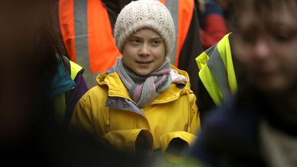 Climate activist Greta Thunberg, from Sweden marches with other demonstrators as she participates in a school strike climate protest in Bristol, south west England, Friday, Feb. 28, 2020. - Sputnik Italia
