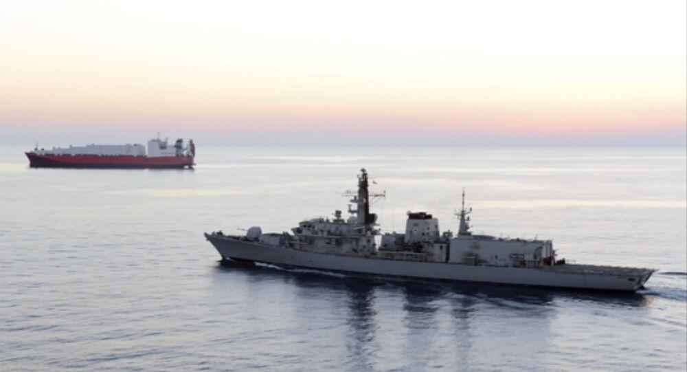 British navy vessel HMS Montrose escorts another ship