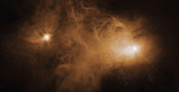 La nebulosa a riflessione Caldwell 68 (NGC 6729) a 400 anni luce nella costellazione della Corona Australe. - Sputnik Italia