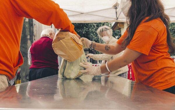 Volontari al lavoro - Sputnik Italia