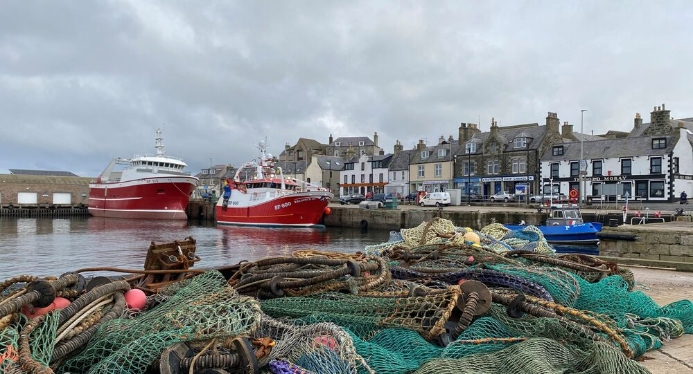 View of fishing boats and a net in the coastal town of Macduff, Aberdeenshire, Scotland, Britain October 18, 2020