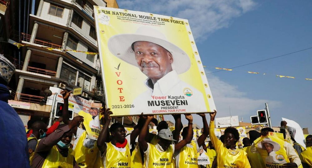 Polling agents from the National Resistance Movement (NRM) party celebrate the victory of Uganda's President Yoweri Museveni in the concluded general elections in Kampala, Uganda January 16, 2021. REUTERS/Baz Ratner
